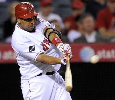 Angels' Juan Rivera takes aim before launching two-run homer. (Associated Press / The Spokesman-Review)