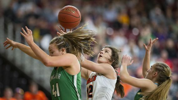 West Valley's Jillian Taylor, center, shoots and scores between Tumwater defenders during the semifinals of the 2A Hardwood Classic girls basketball tournament on Friday, March 6, 2020 at the Yakima SunDome in Yakima, Wash. (Evan Abell / Yakima Herald-Republic)