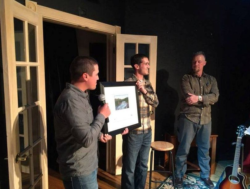 Sean Visintainer, left, and Michael Visintainer, center, of Silver Bow Fly Shop in Spokane Valley are honored by the Spokane Riverkeeper for conservation service to the river. (Courtesy)