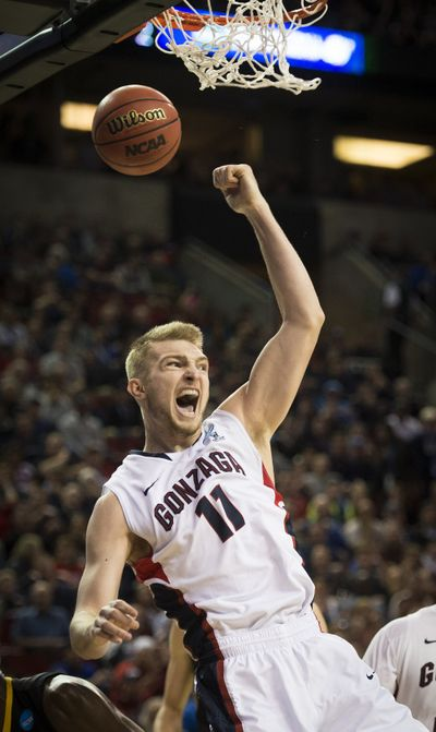 Gonzaga forward Domantas Sabonis is fired up after a slam dunk in the first half. (Colin Mulvany)