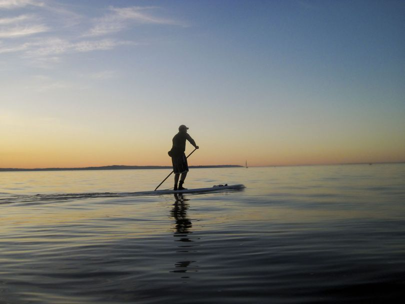 Rob Casey demonstrates stand up paddling on his board in Puget Sound. (Courtesy photo)