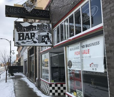 The Checkerboard Bar, at 1716 E. Sprague Ave., which claims to have the oldest liquor license in Spokane, has closed and is listed for sale. (THOMAS CLOUSE / SR)