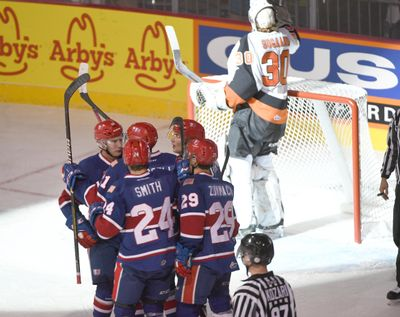 The Spokane Chiefs celebrate a goal by Ethan McIndoe against Medicine Hat on Oct. 5 at the Spokane Arena. (Jesse Tinsley/THE SPOKESMAN-REVI / SR)