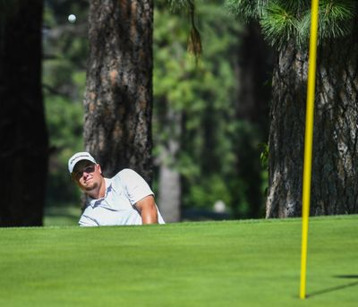 Derek Bayley chips onto the ninth green at Indian Canyon Golf Course during the 2018 Rosauers Open.  (Dan Pelle / The Spokesman-Review)