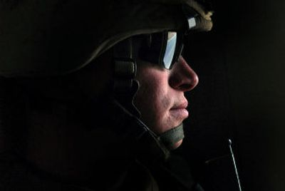Undivided attention: Sunlight pierces a tiny bulletproof glass window, through which Cpl. Matthew Shipp, of India Battery of the 3rd Battalion, 11th Marine Regiment, keeps a watchful eye. His  Mine Resistant Ambush Protected vehicle (MRAP) was patrolling the streets of Rutbah in western Iraq.