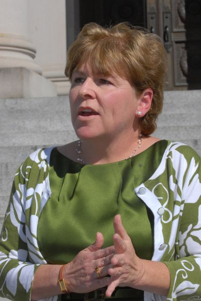 State Sen. Lisa Brown, D-Spokane, talks to reporters on the steps of the state Supreme Court in Olympia after a hearing on her challenge to a state law requiring a supermajority to increase taxes.  (Richard Roesler / The Spokesman-Review)