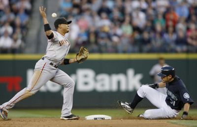 Giants' Emmanuel Burriss forces Ichiro Suzuki at second base but fails to make the relay to first.  (Associated Press / The Spokesman-Review)