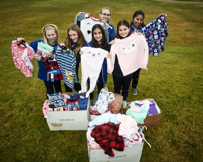 The St. Mary's Catholic School student council members, from  left, back row, Kenedie Witherow and Emelia Tilleman; and, front, Beth Olstad,  Hadassah D.,  Olivia Wehr and Grace Dierks, have organized a pajama drive for the Christmas Bureau. (Colin Mulvany / The Spokesman-Review)