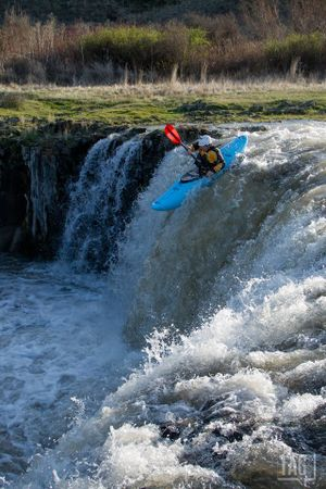 Brian Jamieson claims first kayak descent of Towell Falls in the BLM's Rock Creek/Escure Ranch area 20 miles south of Sprague, captured by photographer Michael Kinney. Wahoo! (Michael Kinney)