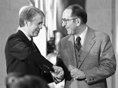 In  this 1977  photo, President JImmy Carter congratulates Griffin Bell after Bell took the oath of office as attorney general during a ceremony at the Justice Department.  (File Associated Press / The Spokesman-Review)