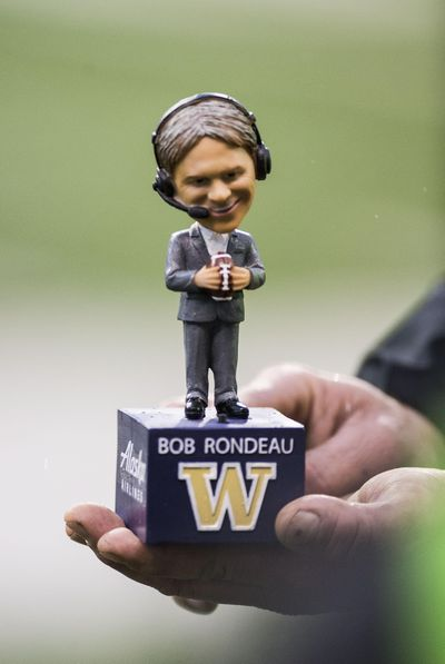 The University of Washington Honored long-time radio broadcaster Bob Rondeau with a bobble-head doll for fans attending the Apple Cup at Husky Stadium, Saturday, Nov. 25, 2017, in Seattle, Wash. Rondeau is retiring after 36 season with the Huskies. (Dan Pelle / The Spokesman-Review)