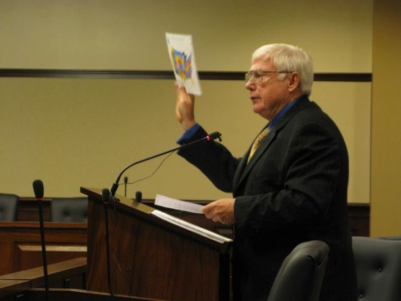 Rep. Jim Clark, R-Hayden Lake, holds up a map showing all the states considering some type of legislation opposing national health care reforms, like his HB 391a, the