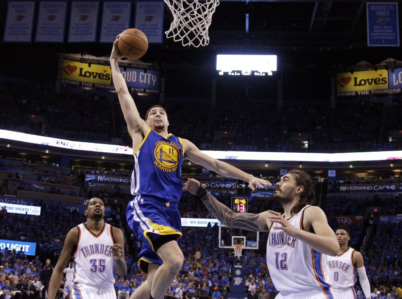 Warriors guard Klay Thompson drives for two of his 41 points in Saturday's Game 6 win over the Thunder. (Sue Ogrocki / Associated Press)