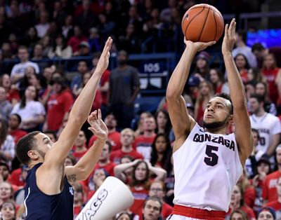 Gonzaga guard Nigel Williams-Goss, right, shoots a 3-pointer as San Diego guard Tyler Williams defends during second half of a NCAA college basketball game on Thursday in the McCarthey Athletic Center. (Colin Mulvany / The Spokesman-Review)