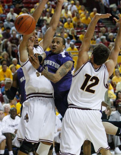 Venoy Overton and the Huskies earned a split in Arizona.  (Associated Press / The Spokesman-Review)