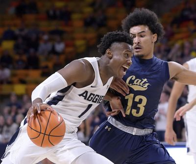 Utah State's Koby McEwen drives to the basket during the Aggies' win Monday. McEwen, who left Wednesday's game with an ankle injury but is expected to play, brings strong credentials from last season (14.9 points, 5.1 rebounds, 3.1 assists). (Eli Lucero / Associated Press)