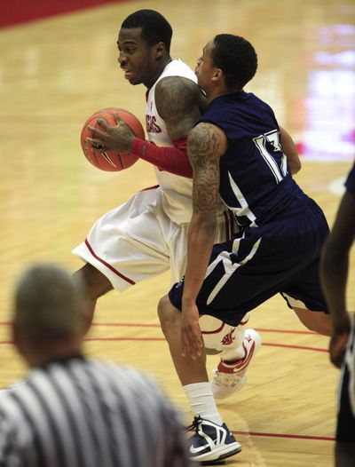 WSU's Mike Ladd, left, drives against Jackson State in last week's game at Pullman. (Associated Press)