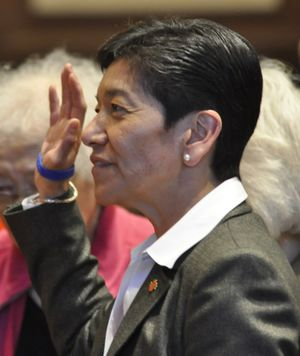 OLYMPIA -- King County Superior Court Judge Mary Yu takes the oath of office Tuesday as a member of the state Supreme Court.  (Jim Camden)