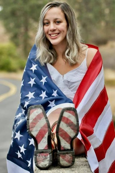 This senior picture of Sierra Athos was rejected for the Lewis and Clark High School yearbook. The high school said the flag is improperly displayed per U.S. code and serves as a prop.  (courtesy photo)