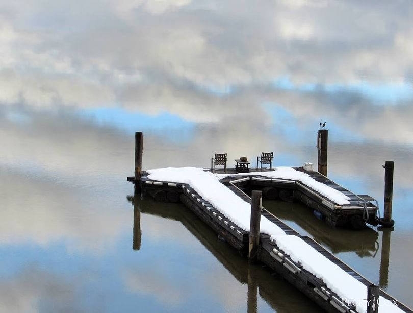 A dock at Priest Lake seems to float in the clouds on a calm Tuesday, Feb. 16, 2016. (Pecky Cox)