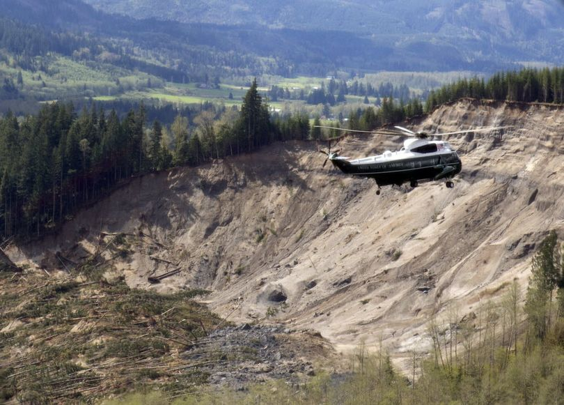 Marine One flies over the site of the March 22 mudslide taking President Obama to Oso on April 22. (AP)