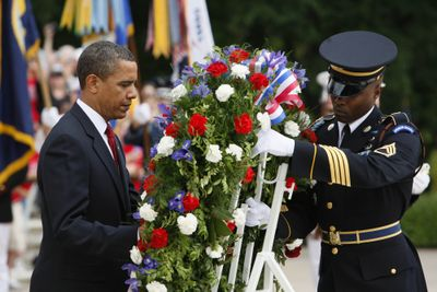 President Barack Obama lays a wreath at the Tomb of the Unknowns on Monday at Arlington National Cemetery.  (Associated Press / The Spokesman-Review)