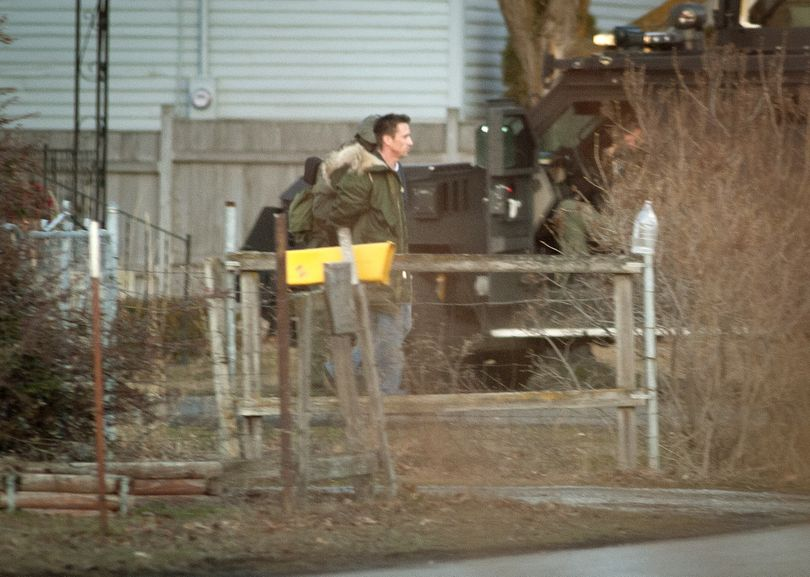 After a three-hour standoff, suspected gunman Ryan Lancaster, 39, surrenders to the Spokane County SWAT team that surrounded a home he had entered near the intersection of North Pines Road and Valleyway on Wednesday afternoon. (Colin Mulvany)