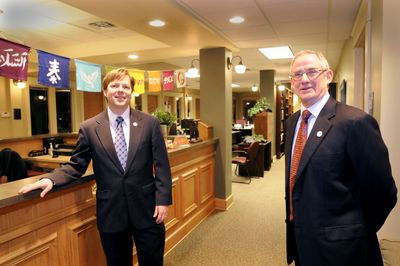 Director Breean Beggs, left, and founder Jim Sheehan stand in the lobby of the Center for Justice,  in Spokane's Community Building.  (Jesse Tinsley / The Spokesman-Review)
