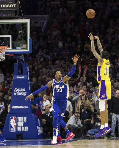 Los Angeles Lakers Brandon Ingram, right, shoots a winning three-point basket over Philadelphia 76ers' Robert Covington, left, during the second half of an NBA basketball game, Thursday, Dec. 7, 2017, in Philadelphia. (Chris Szagola / Associated Press)