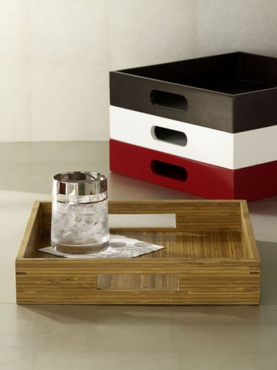 This undated photo provided by West Elm shows square wood trays for TV dining.   (Associated Press / The Spokesman-Review)