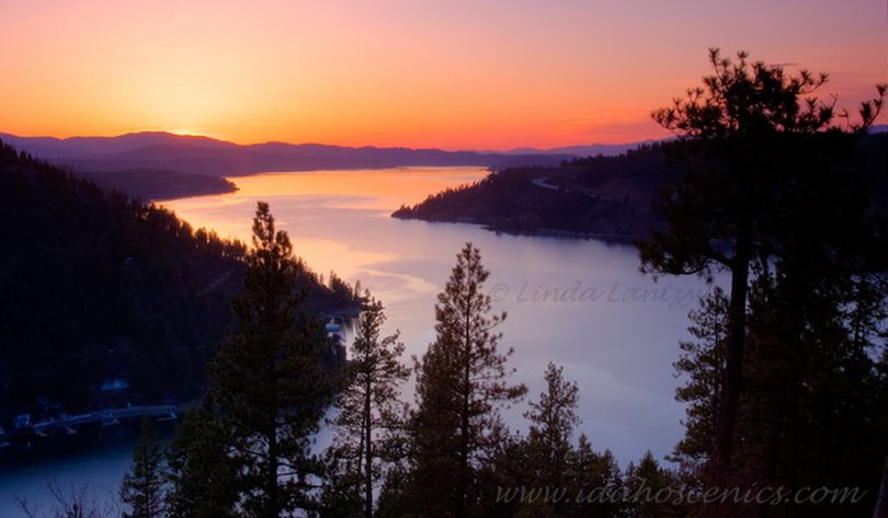 Sunset over Lake Coeur d'Alene's Wolf Lodge Bay from the Mineral Ridge hiking trail. (Linda Lantzy / Idaho Scenic Images)