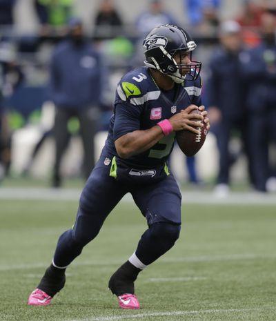 Seattle Seahawks quarterback Russell Wilson has had incredible success against the Cardinals in Arizona. (Stephen Brashear / Associated Press)