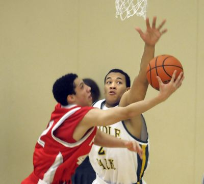 Shadle Park's Anthony Brown shows his versatility with solid defense against Ferris last Friday. (Christopher Anderson / The Spokesman-Review)