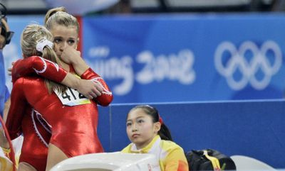 A teammate consoles United States gymnast Alicia Sacramone after her two mistakes proved costly during a team finals loss to China today at the Beijing Olympics.  (Associated Press / The Spokesman-Review)