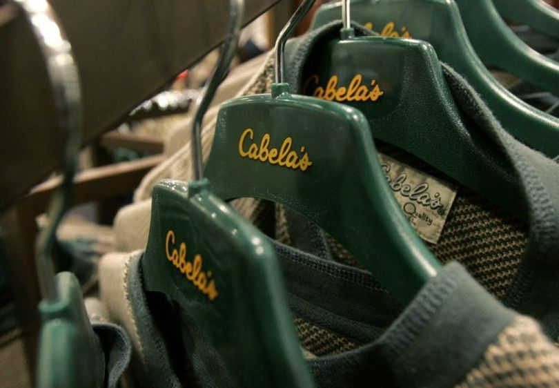 Shirts hang on hangers at the Cabela's store in Lacey, Wash. Cabela's announced today that it may sell all or part of itself as it looks to boost shareholder value. (AP Photo/Ted S. Warren, File)