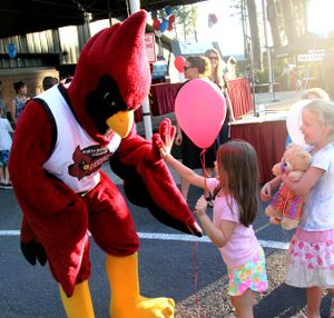 Cecil the Cardinal high-fives kids after the winners were announced at the NIC Foundation's Really BIG Raffle Wednesday. (Tom Greene/North Idaho College Press Room photo)