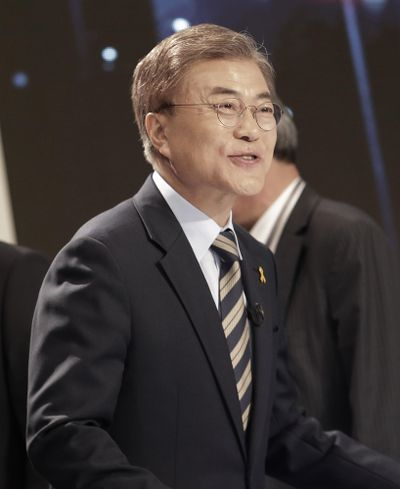 South Korean presidential candidate Moon Jae-in of the Democratic Party of Korea smiles as he prepares for a televised debate for the upcoming May 9, 2017, presidential election in Seoul, South Korea, Tuesday, May 2, 2017. (Ahn Young-joon / Associated Press)
