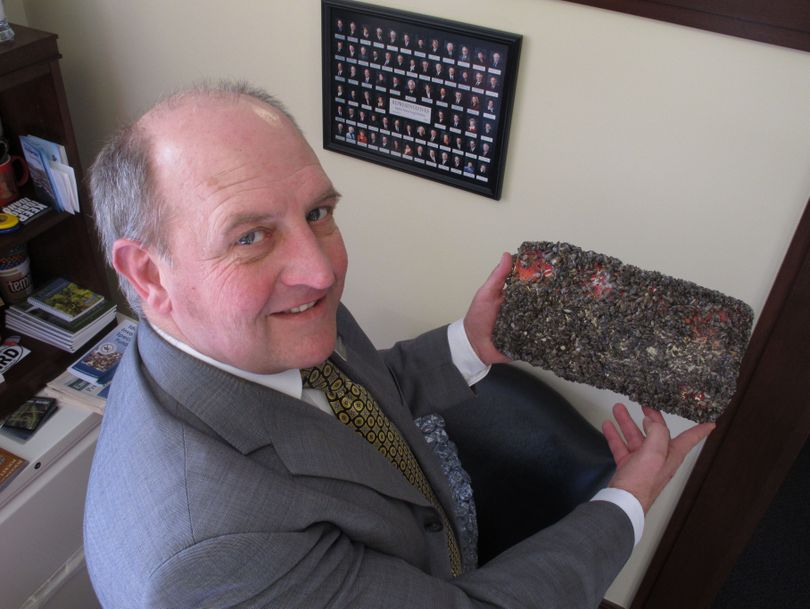 Idaho state Rep. Eric Anderson poses with an Idaho license plate he left for six months in Lake Mead to be encrusted with quagga mussels. (Associated Press)