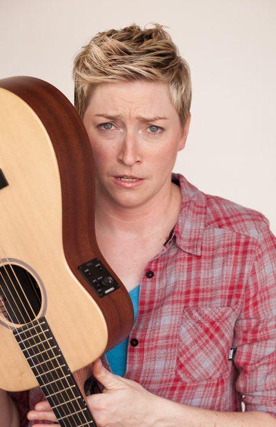 Comic Kristin Key, and her guitar, headline the Spokane Comedy Club on Friday and Saturday.  (Tandem Photo)