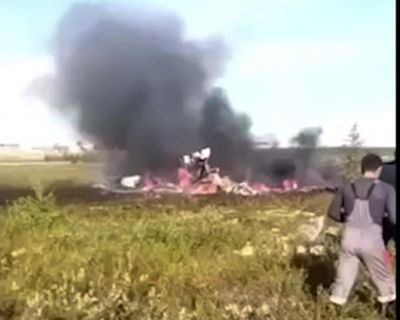 Smoke rises from a crash side of a Russian helicopter Mi-8 crashed shortly after takeoff in Vankor, above the Arctic Circle in Siberia, Russia, Saturday, Aug. 4, 2018. (Associated Press)
