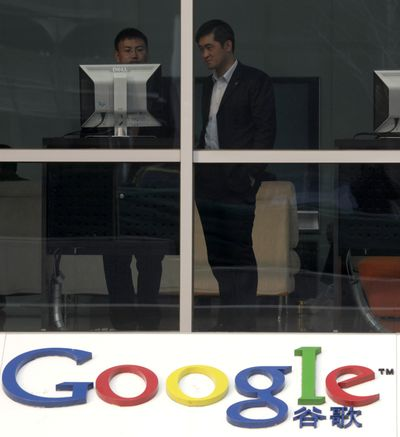 Men use a computer in the reception area of Google's China headquarters in Beijing. Google's threat to end its China operations has alarmed an Internet-connected public that is the world's largest at 384 million people.  (Associated Press / Associated Press)