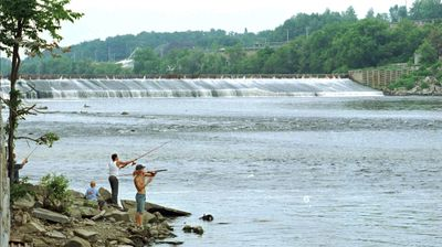 This July 1997 file photo shows Edwards Dam on the Kennebec River in Augusta, Maine. Conservationists this month celebrated the 10th anniversary of the breaching of the 24-foot-high, 917-foot-wide dam.  (File Associated Press / The Spokesman-Review)