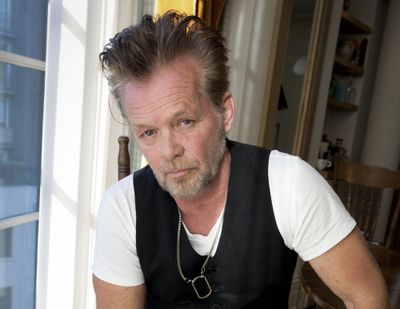 """Singer-songwriter John Mellencamp poses for a portrait to promote his album """"Plain Spoken"""" on Sept. 22, 2014, at the Greenwich Hotel in New York. Just days before the Super Bowl, John Mellencamp sunk to his knees in support for the Black Lives Matter movement after performing a political ballad on the """"Late Show With Stephen Colbert."""" (Amy Sussman / Amy Sussman/Invision/AP)"""