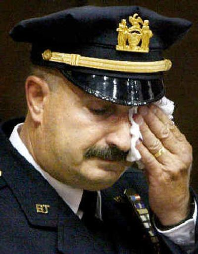 Port Authority police Lt. John McLoughlin wipes his eyes during an emotional final roll call in New York on Wednesday.   (Associated Press / The Spokesman-Review)