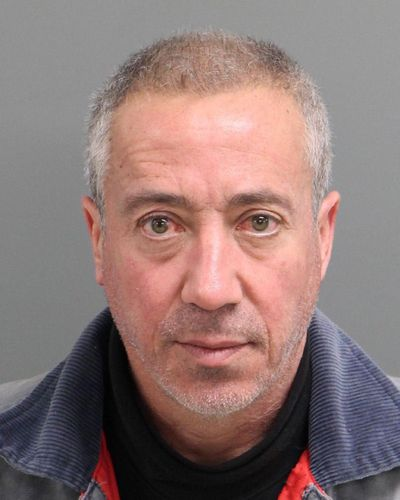 This undated mug shot shows Christian Desgroux, 57, who's accused of pretending to be a U.S. Army general when he landed a chartered helicopter at a technology company in North Carolina in November. (Associated Press)