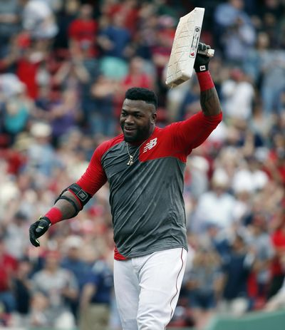 Boston's David Ortiz holds up second base after hitting a game-winning RBI double in the 11th inning against the Houston Astros. (Michael Dwyer / Associated Press)