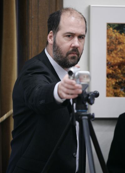 In this 2007 file photo, Krist Novoselic, uses a camera to record a news conference.  (File Associated Press / The Spokesman-Review)