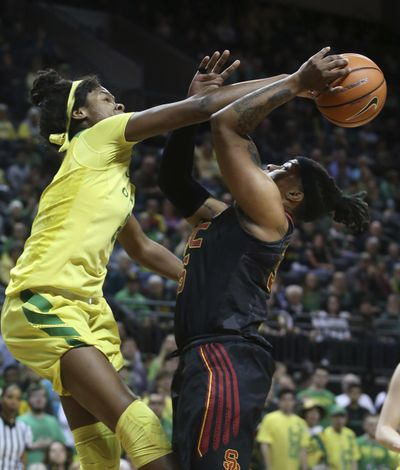 Oregon's Ruthy Hebard, left, blocks a shot by South California's Kristen Simon during the first half of an NCAA college basketball game Friday, Feb. 16, 2018, in Eugene, Ore. (Chris Pietsch/The Register-Guard via AP) ORG XMIT: OREUG101 (Chris Pietsch / AP)