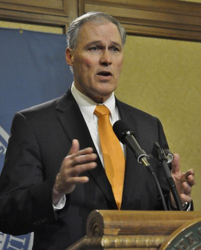 OLYMPIA – Gov. Jay Inslee tells reporters he vetoed 27 bills after lawmakers failed to come up with a supplemental budget in the regular session. Their special session started Thursday about 30 minutes after the regular session ended. (Jim Camden / The Spokesman-Review)