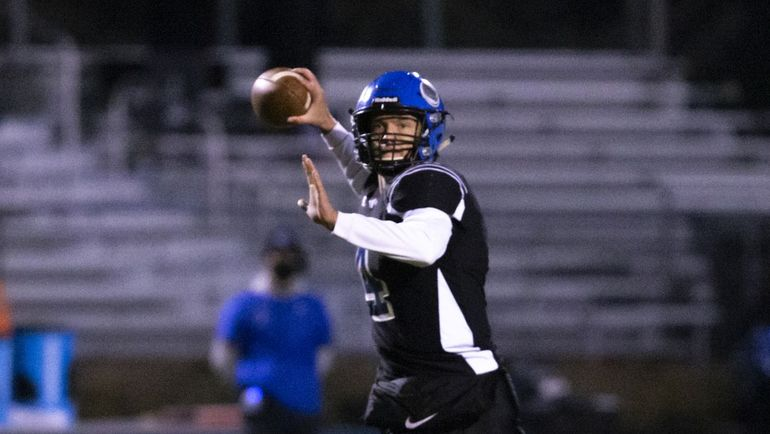 Coeur d'Alene senior quarterback Jack Prka, throwing during the 5A State quarterfinal against Timberline on Nov. 6, was selected Inland Empire League 5A Most Valuable Player.  (Cheryl Nichols/For The Spokesman-Review)